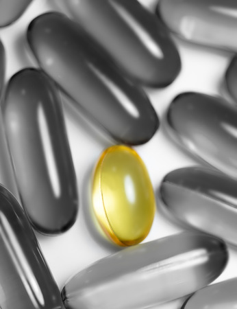 food supplement: Fish oil and food supplement  pills macro vertical isolated on white