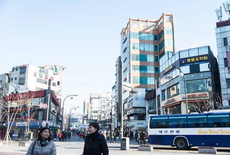 cross street: Seoul , South Korea - January 3, 2015 : People cross street at urban area in Seoul ,South Korea