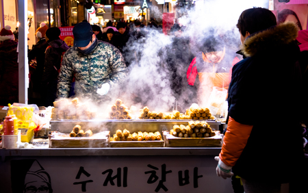 Seoul, Republic of Korea - January 1, 2015 : Traditional Korean street food market scene  at Myeongdong district ,famous shopping street, at night  in Seoul capital of South Korea.