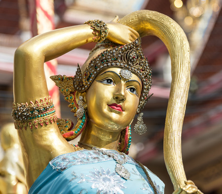 Earth goddess bronze statue  closeup on face in Thai style temple same concept as mother earth named Gaia in Greek mythology