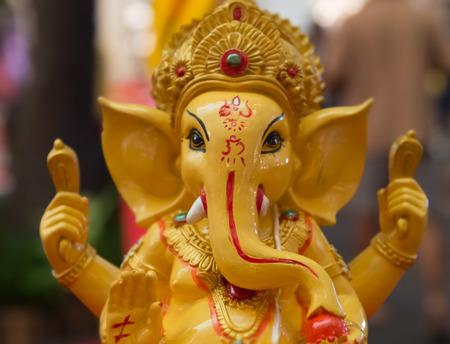 parvati: Yellow rasin Ganesh Elephant god  in Hindu mythology statuecloseup focused on face