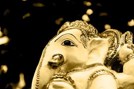 parvati: White  Ganesh Elephant Hindu god statue closeup focused on face golden vintage tone