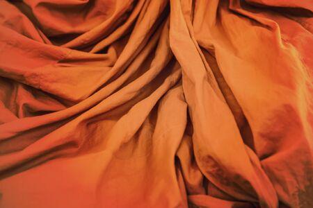 thai monk: Orange robe with ripple  of Thai Monk closeup background Stock Photo