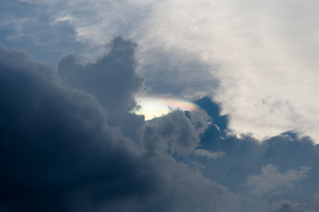 atmospheric phenomena: Rainbow clouds (iridescent or irisation) with cloudy sky near sunset time