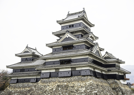 Masumoto Castle , Black palace for war in autumn at nagano province in  Japan with clear sky