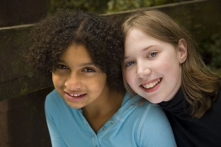 image of two girls of different skin tones....friendship Stock Photo - 2034110