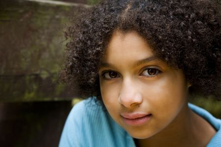 preteens girl: sweet expression on this pretty biracial girl