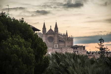 A picture pf the Cathedral of Mallorca and the Harbour of Palma during de Sunrise in the Winter Sunrise Stock Photo
