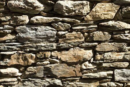 irregular shapes: Volcanic stones background wall of irregular shapes