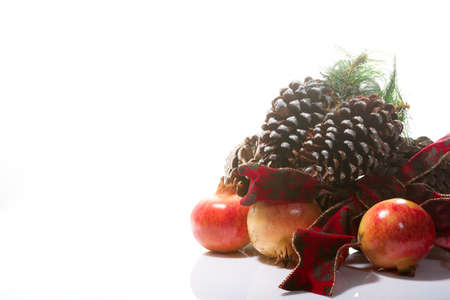beautiful Christmas composition with pinecones and pomegranates on a white background Stock Photo