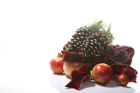 pinecones: beautiful Christmas composition with pinecones and pomegranates on a white background Stock Photo