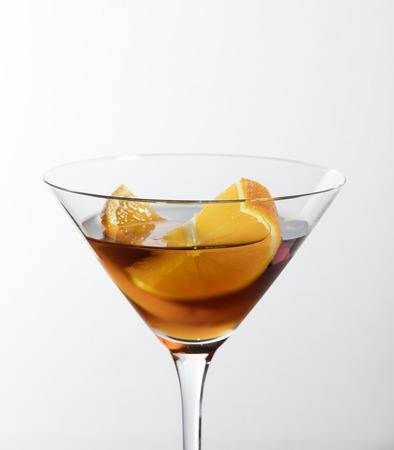 classic vermouth red with orange slice on a white background