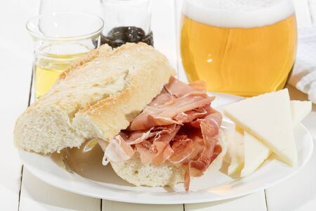 cured ham: cured ham sandwich with olive oil cheese and cold beer Stock Photo