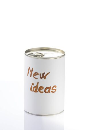 metaphorical: can full of new ideas pending to open, metaphorical photo for business man and creative people