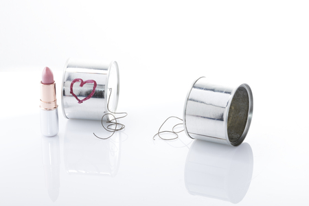 metaphoric: break up metaphoric photo, two cans with a break line communication between them Stock Photo