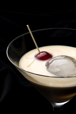 baileys: Irish cream whiskey with ice and a sweet cherry Stock Photo