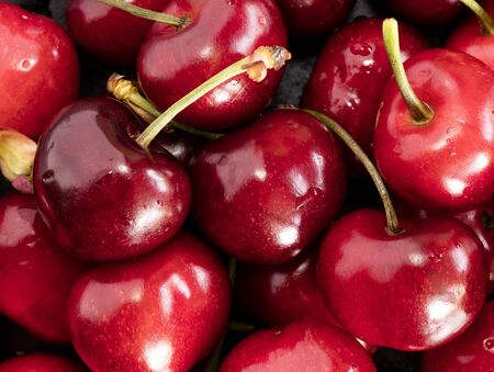 full red: fresh cherries on a black stone, big size photo, high resolution