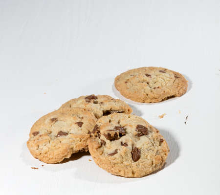 chunks: cookies with chocolate chunks on a white wooden table Stock Photo
