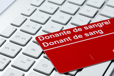 blood donor card color red on  keyboard laptop