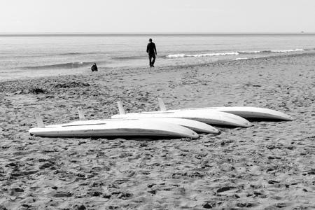 windsurf tables on the sand in a mediterranean beach