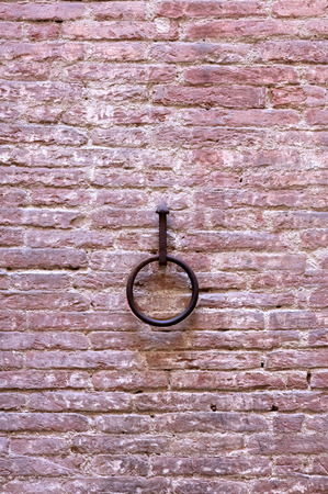 background with a rusty ring centered on an old adobe brick wall