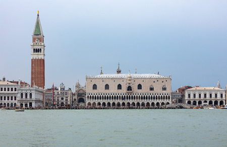 San Marcos square in Venice, seen from the sea with hundreds of tourist walking on the edge of the lagoon Banco de Imagens