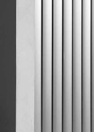 exterior wall made with vertical aluminum strips, lighting with shades of gray gradient