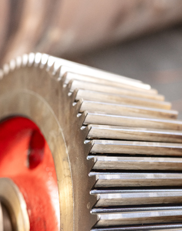 cogwheel of a helical gear in a gearbox, detail of the teeth with a red mark