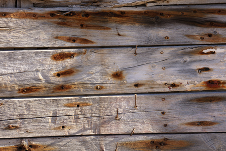 very old wooden planks, with rusty nails and orange markings. Photo with high resolution and texture 免版税图像