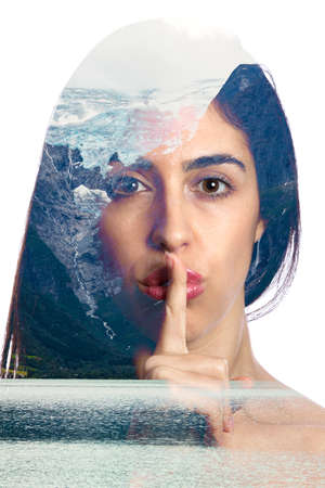 double exposure photo with a girl asking for silence and a glacier melting on the background inside of the girl face. Conceptual photography about climate change