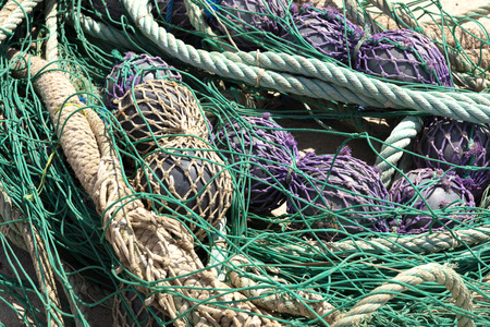 fishing nets in the port to be revised, there are blue, purple and green