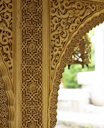 arch decorated with arabic ornaments in brown color