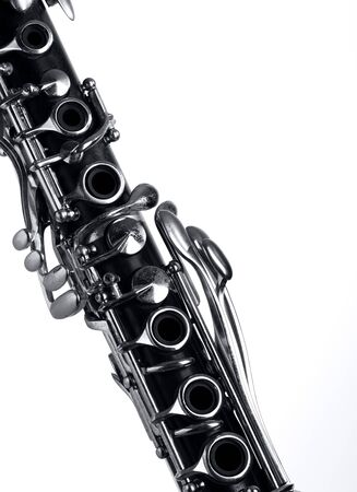part of the old clarinet body, with the silver mechanisms on the wood. white background and free space for text