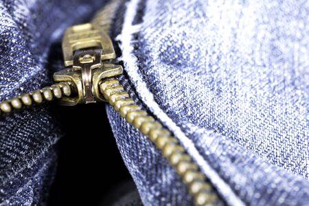 classic brass zipper in a light blue jeans