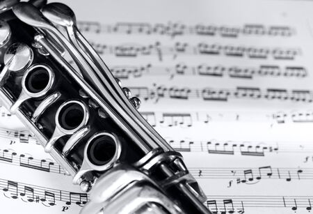 part of the clarinet body on a partiture with printed notes
