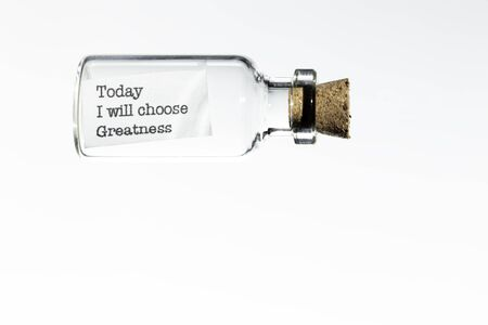 glass bottle with a message inside  and cork tap on a white background Banco de Imagens