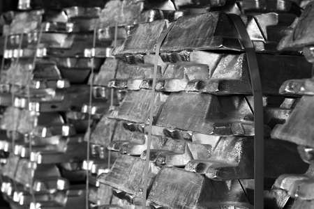 industry background picture of aluminum ingots stacked and stored, black and white photography Banco de Imagens