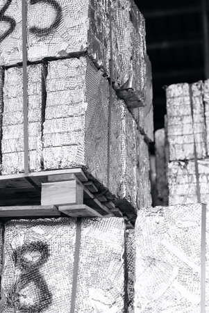 unpainted aluminum scraps pressed in cubes, black and white photography 免版税图像