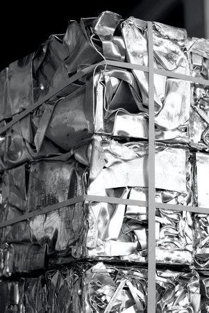unpainted aluminum scraps pressed in cubes, black and white photography Banco de Imagens