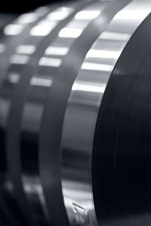 aluminum strips wound on coils, industrial background photo 免版税图像