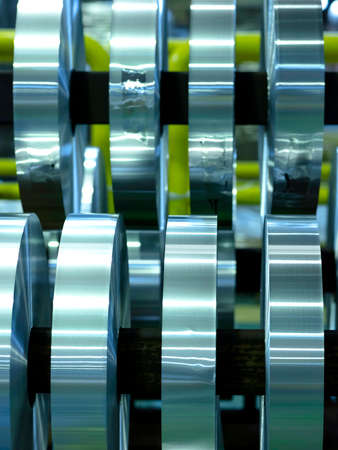 coils of aluminum foil after sliting, industrial background 免版税图像