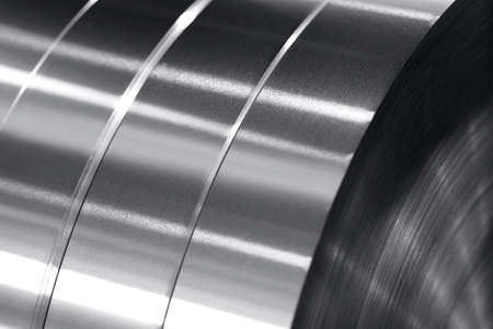 aluminum strips wound on coils, industrial background photo in black and white 免版税图像