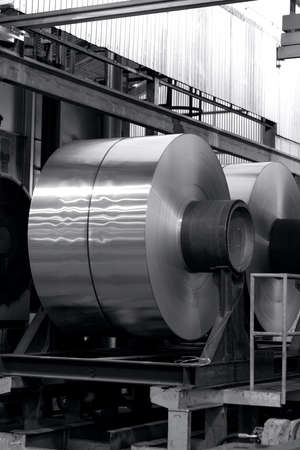 big coils of aluminum on the table before the annealing process, black and photo 免版税图像