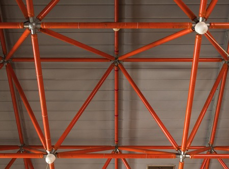 industrial ceiling made of red iron beams Stock Photo