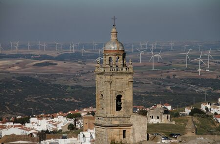 Tower, city of Medina Sidonia and fields Stock Photo
