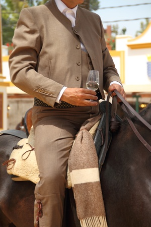 Rider with a glass of sherry