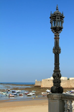 Streetlight along the creek to the beach, Cádiz, Spain