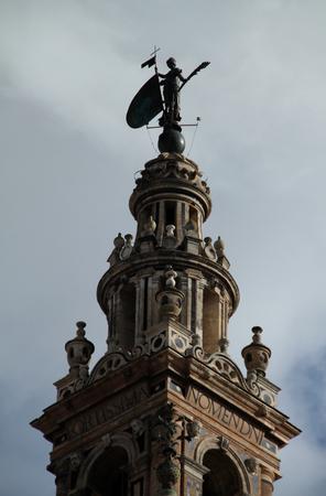 The vane of the Giralda giraldillo in Seville Stock Photo