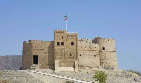 Fujairah Fort against deep blue sky, built in 1670, considered the oldest fort in the UAE , City of Fujairah, Fujairah Emirate, United Arab Emirates