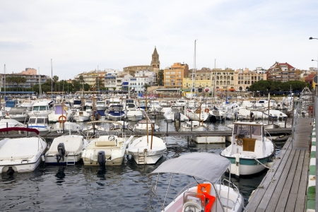 Port and touristic village of Palamós, Costa Brava (Catalonia, Spain) .Many fishing boats moored.